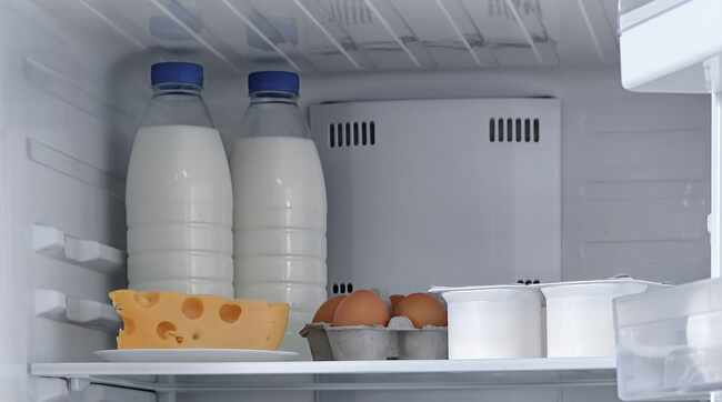 Liquid dairy products at back - fridge organization