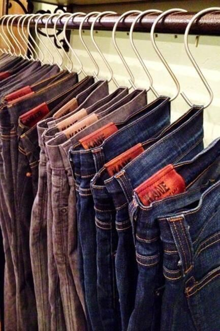 organization hacks - hang your jeans in shower hooks