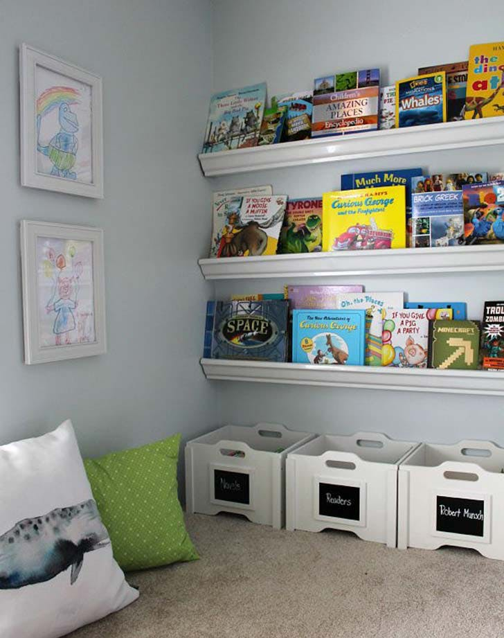 rain gutter shelves as book storage