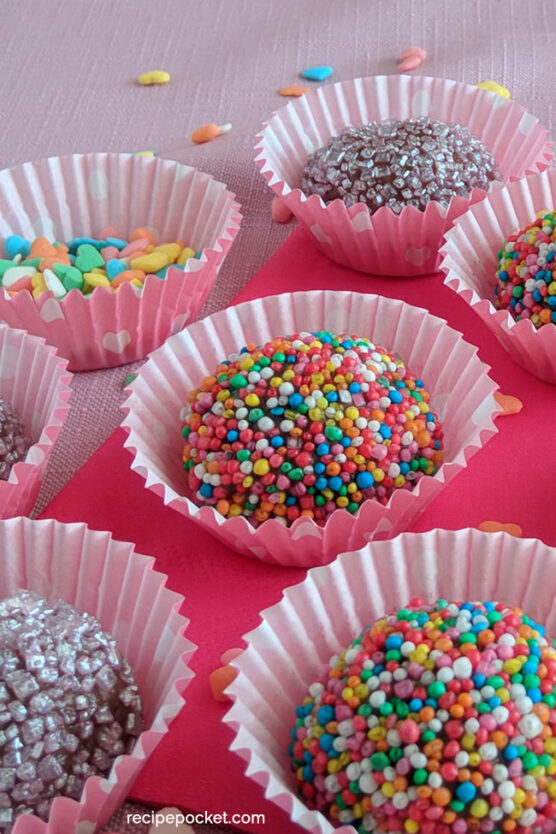 Chocolate truffles coated with colorful sprinkles and crystal sugar