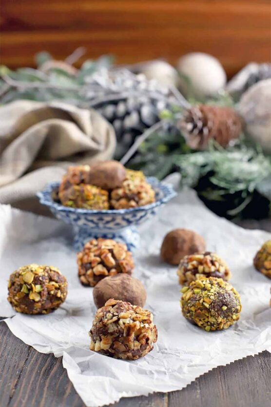 Dark chocolate truffles coated with almonds, pistachios, and hazelnuts