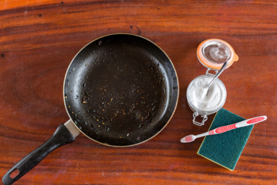 Use baking soda mixture to clean burnt pans